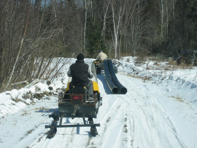 ATV pulling hydro pipe
