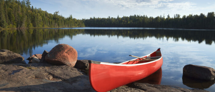 Photo of a Canoe near the Water's Edge During One of Our Recent Algonquin Adventures.