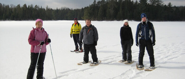 Photo of a Small Group Snowshoeing inside Algonquin Park.