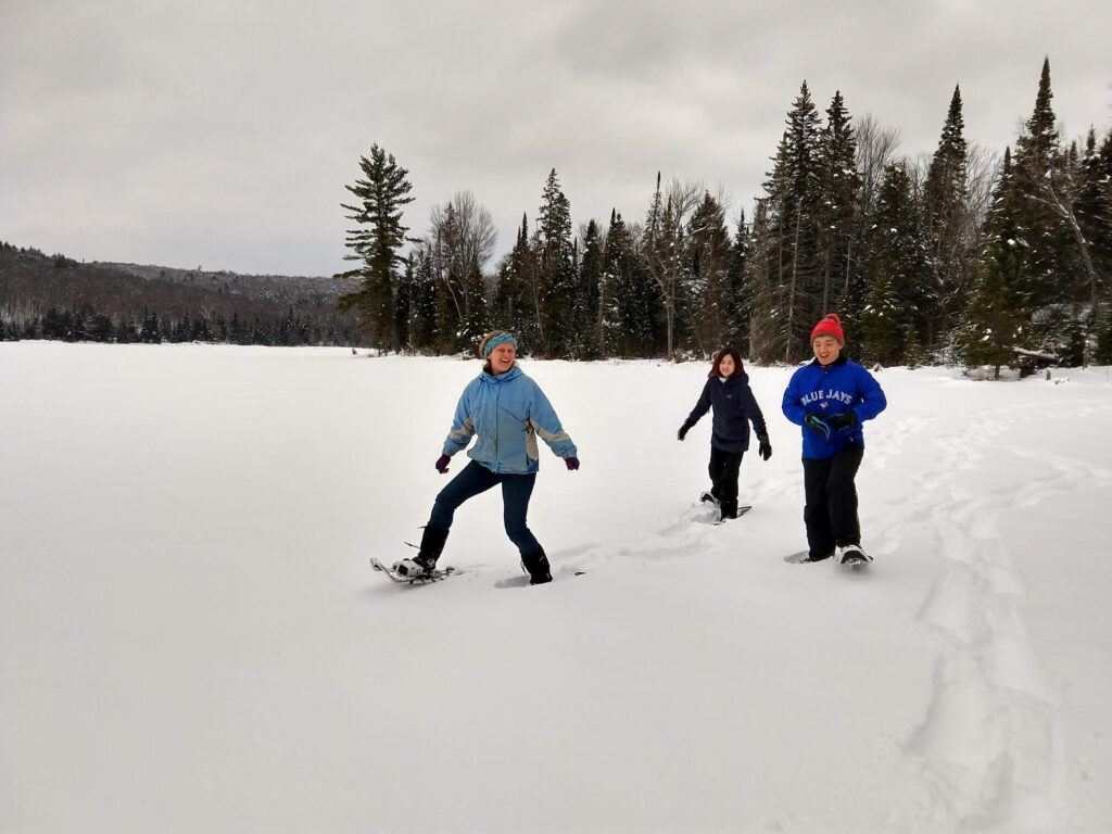 Photo of Three Children Snowshoeing near the Eco-Lodge, One of the Best Family Reunion Destinations in Ontario.