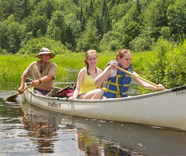 Photo of a Group of Canoers near Our Forest Eco Lodge.